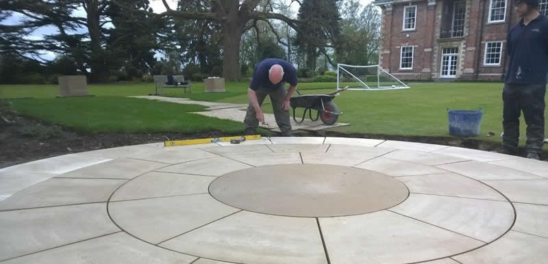 Dave the landscaper laying perfect slabs