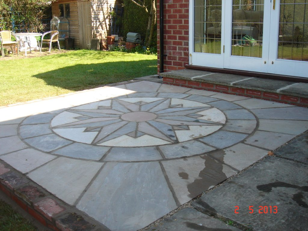 Ryland Horticulture Ltd. Supplying and laying a compass paving feature.